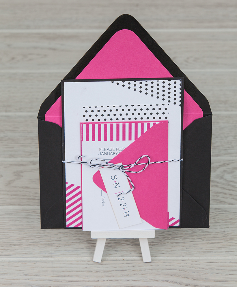 Bold pink and black bundled wedding invitation